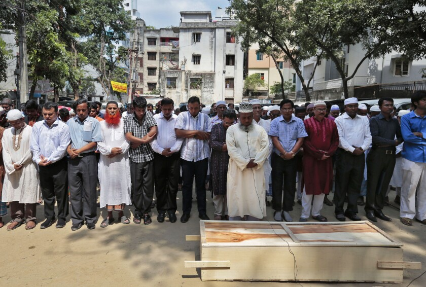 Bangladeshi Muslims attend the April 26 funeral of Xulhaz Mannan, the editor of an LGBT magazine who was stabbed to death in Dhaka.