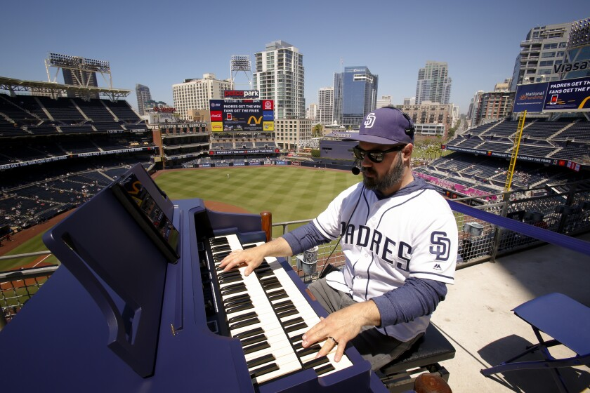 Padres organ player Bobby Cressey gets ready for the game against the Seattle Mariners at Petco Park on Wednesday.