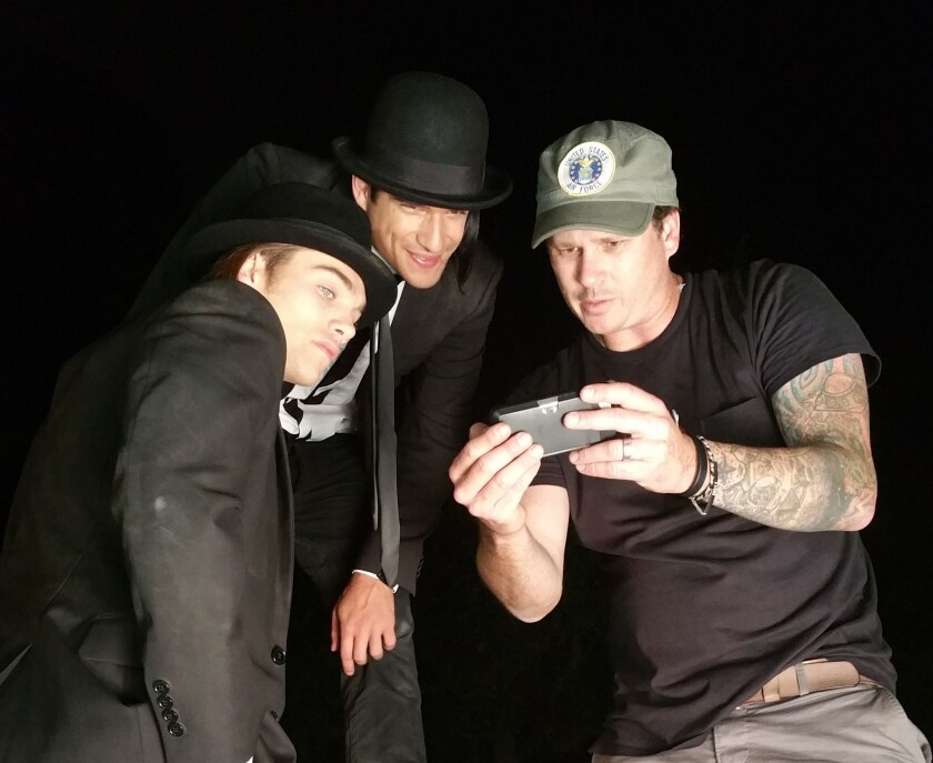 """Dylan Sprayberry, left, Tyler Posey and Tom DeLonge on set of the upcoming and as-yet-untitled short film in DeLonge's """"Poet Anderson"""" franchise."""
