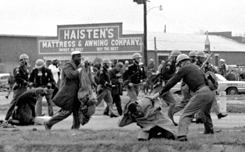 John Lewis and other demonstrators are beaten by Alabama state troopers during a 1965 civil rights march in Selma.