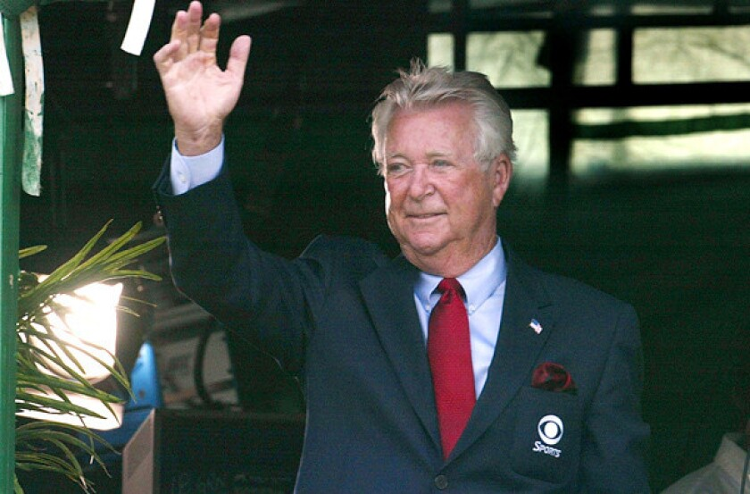 Ken Venturi waves to winner Bob Estes from the broadcast booth during the final round of the Kemper Open in 2002.