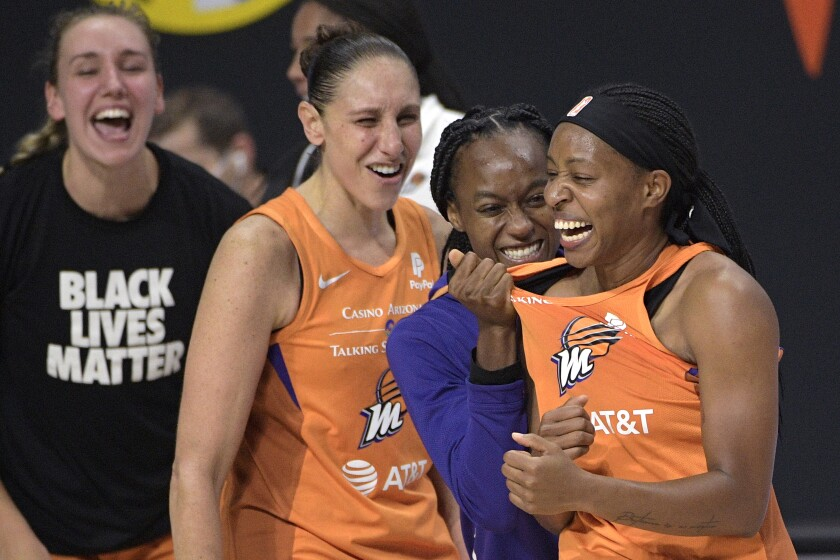 Phoenix Mercury guard Shey Peddy, right, is congratulated by guard Shatori Walker-Kimbrough, second from right, guard Diana Taurasi and forward Alanna Smith, left, after Peddy scored the game-winning shot as time expired against the Washington Mystics during a WNBA basketball first-round playoff game Tuesday, Sept. 15, 2020, in Bradenton, Fla. (AP Photo/Phelan M. Ebenhack)