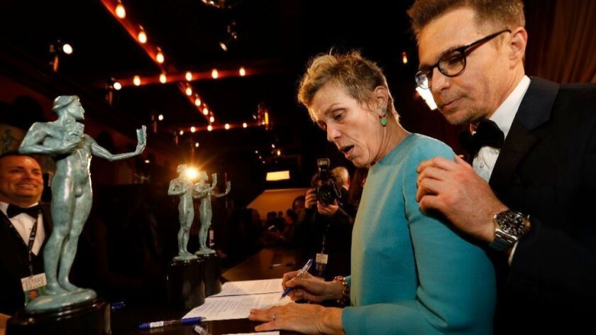 """Frances McDormand and Sam Rockwell backstage after winning Outstanding Performance by a Cast in a Motion Picture, """"Three Billboards Outside Ebbing, Missouri"""" at the 24th Screen Actors Guild Awards."""