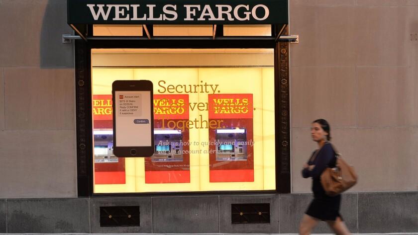 A woman walks past a Wells Fargo bank in Washington, D.C. on Oct. 5.