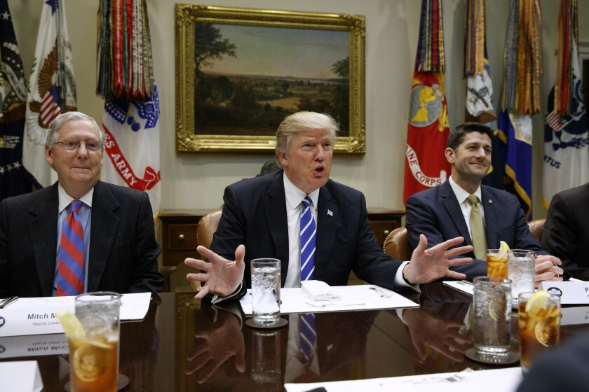 President Trump is flanked by Senate Majority Leader Mitch McConnell (R-Ky.), left, and House Speaker Paul D. Ryan (R-Wis.) at the White House.