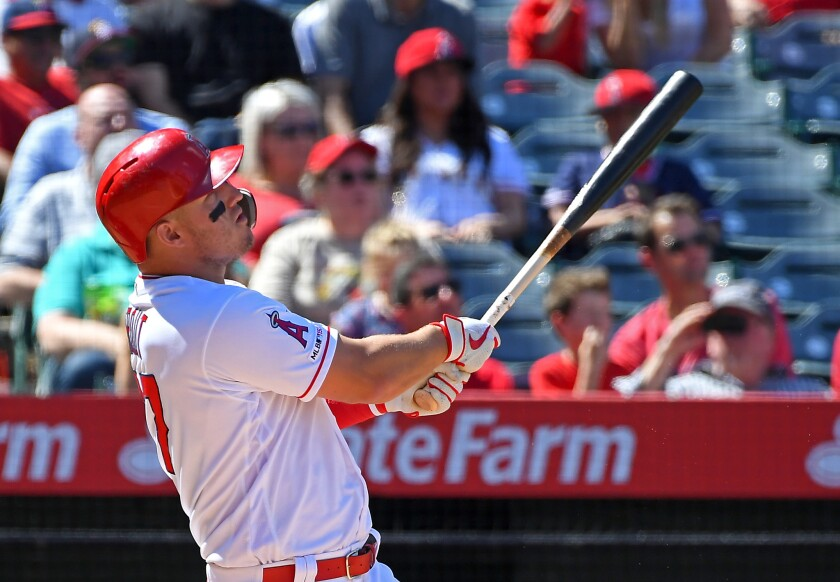The Angels' Mike Trout watches the flight of his grand slam home run April 6 in the fourth inning against the Texas Rangers.