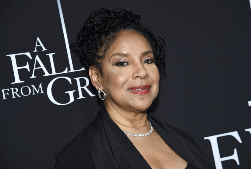 A closeup of Phylicia Rashad in formal wear and jewelry.