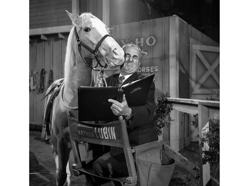 Dec. 1962: Film and television director Arthur Lubin gets a kiss from a friend, Mr. Ed, the talking