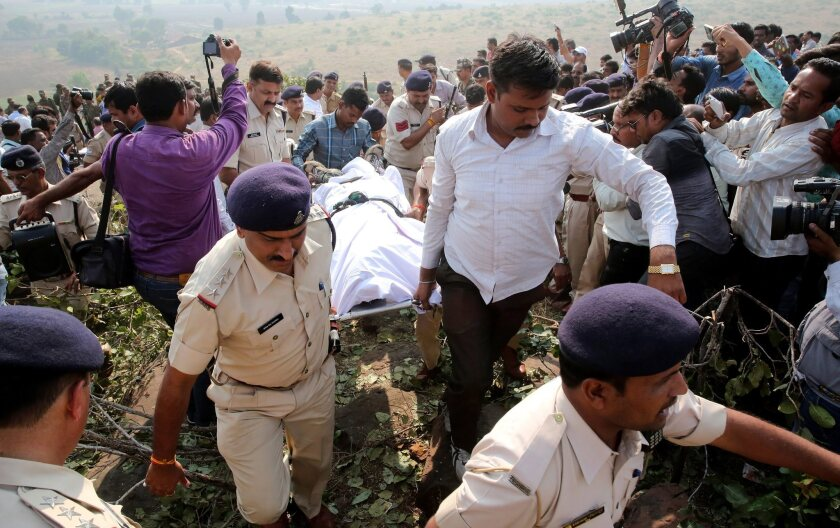 Indian police move the bodies of members of the banned Students Islamic Movement of India, who were killed by officers Oct. 31 outside Bhopal, India.