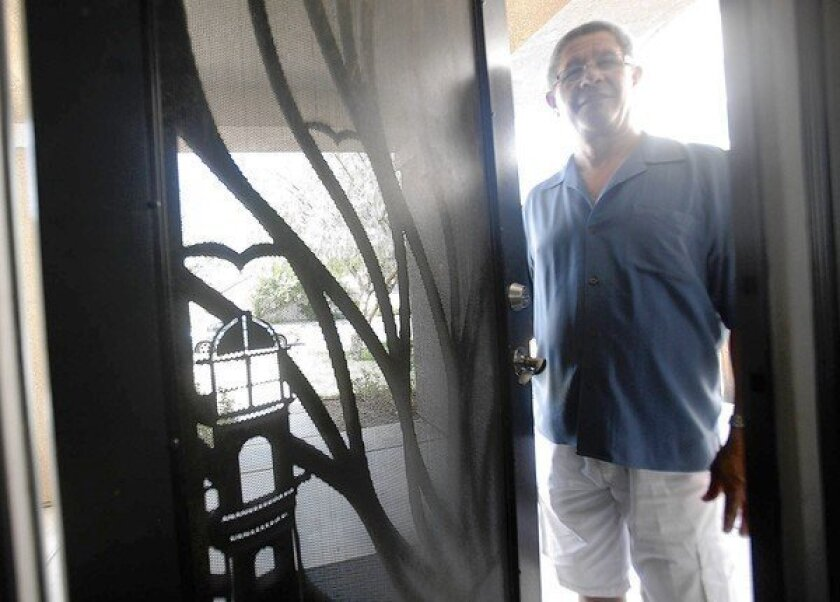 """Hermes Maldonado in the Moreno Valley home he bought last summer despite two foreclosures and two bankruptcies. """"After everything that happened, thank God I was able to buy another house,"""" he says."""
