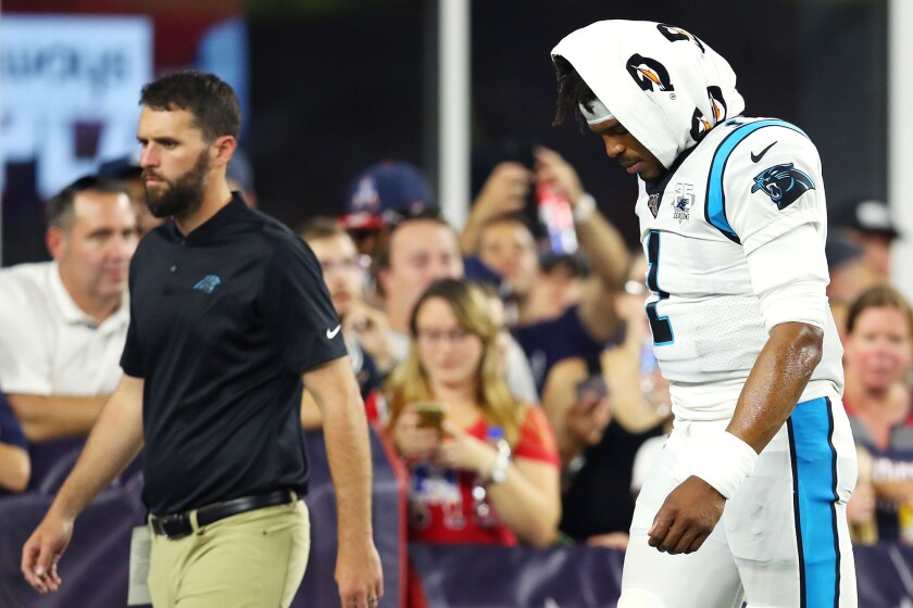 Carolina Panthers quarterback Cam Newton exits the field during Thursday's preseason game against the New England Patriots at Gillette Stadium.