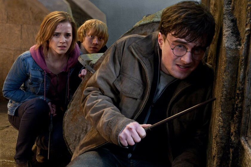 MOVIE---(L-r) EMMA WATSON as Hermione Granger, RUPERT GRINT as Ron Weasley and DANIEL RADCLIFFE as Harry Potter in Warner Bros. Pictures fantasy adventure HARRY POTTER AND THE DEATHLY HALLOWS Ð PART 2, a Warner Bros. Pictures release.