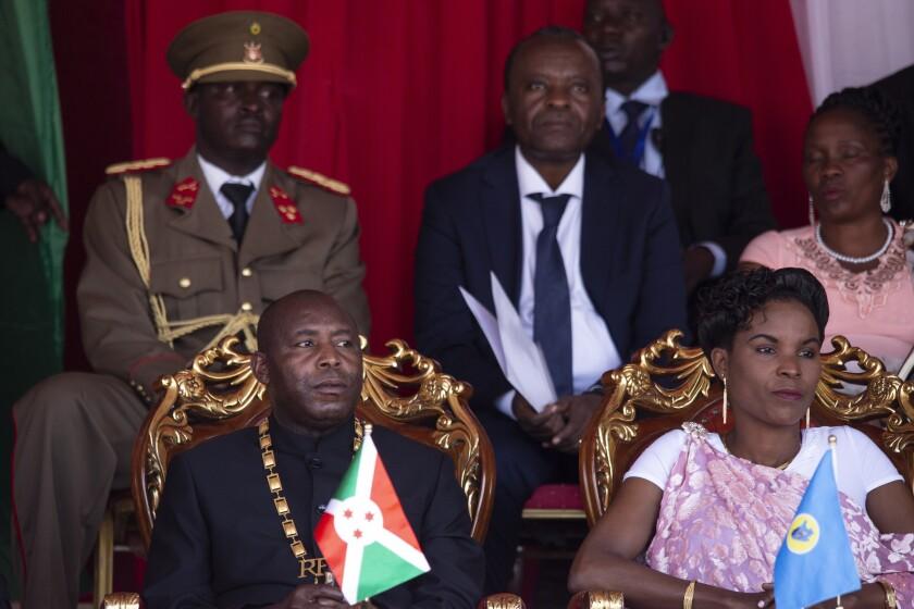 Burundi's President Evariste Ndayishimiye, left, and his wife Angeline Ndayubaha, right, attend his inauguration in Gitega, Burundi, Thursday, June 18, 2020. President Evariste Ndayishimiye took power two months early after the abrupt death of his predecessor Pierre Nkurunziza. (AP Photo/Berthier Mugiraneza)