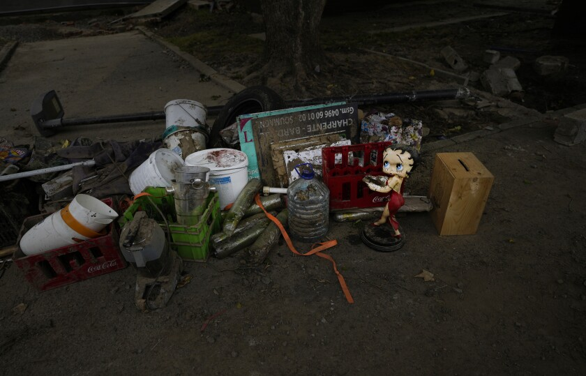 Discarded and damaged household items lay on a roadside after flooding in Vaux-sous-Chevremont, Belgium, Saturday, July 24, 2021. Residents were still cleaning up after heavy rainfall hit the country causing flooding in several regions. (AP Photo/Virginia Mayo)