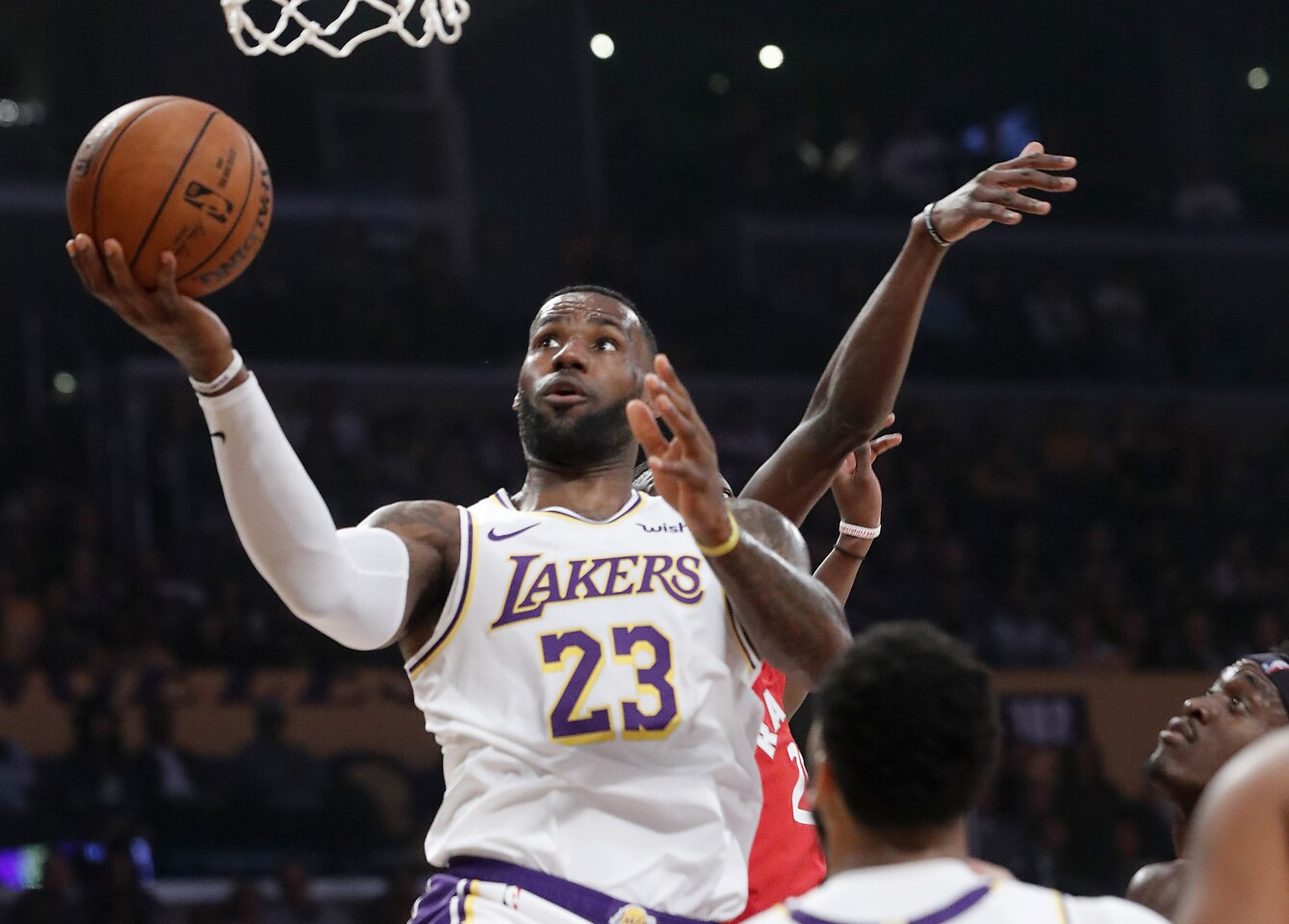 LOS ANGELES, CALIF. - NOV. 10, 2019. Lakers forward LeBron James drives to basket against the Raptors in the first quarter at Staples Center in Los Angeles on Sunday night, Nov. 10, 2019. (Luis Sinco/Los Angeles Times)