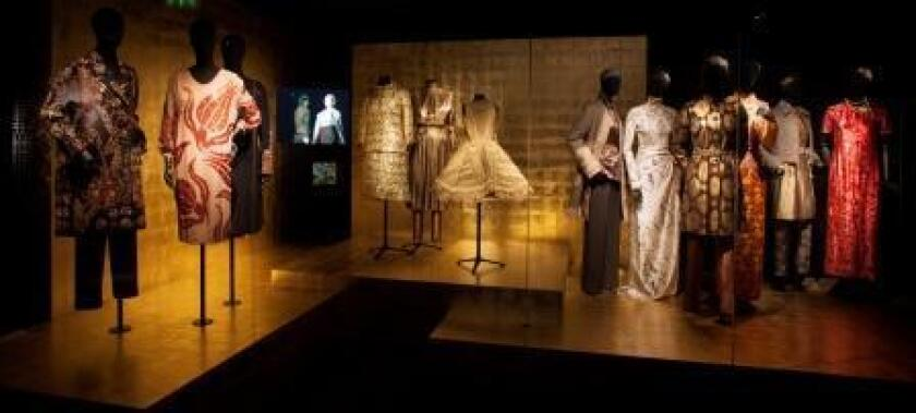"""The """"Gold"""" themed exhibit in the """"Dries Van Noten: Inspiration"""" exhibition includes clothing from the designer's fall and winter collections from 1997 and 2006, a Thierry Mugler dress (1978), Chanel coat (1967) and women's pipiri coat from Greece (1909). The exhibition opens at the Musee des Arts Decoratifs in Paris on Saturday and runs through Aug. 31."""