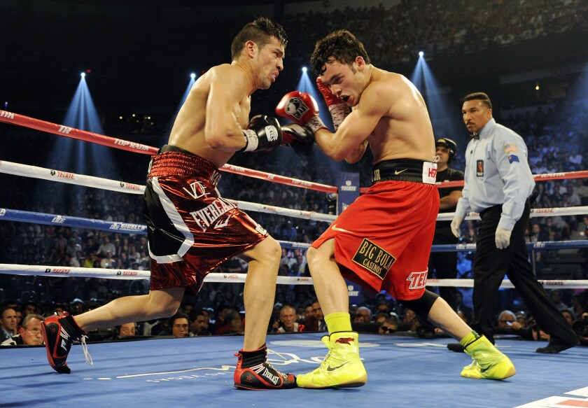 Sergio Martinez (L) trades punches with Julio Cesar Chavez Jr. in the fourth round of their WBC middleweight title fight at the Thomas & Mack Center on September 15, 2012 in Las Vegas, Nevada.