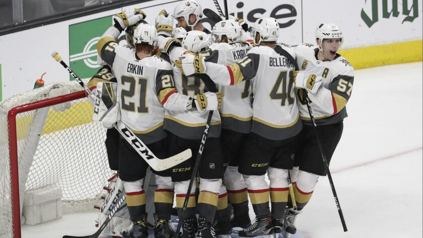 The Vegas Golden Knights celebrate around goalie Marc-Andre Fleury after sweeping the Kings in four games out of Round 1 of the Stanley Cup playoffs at Staples Center on Tuesday.