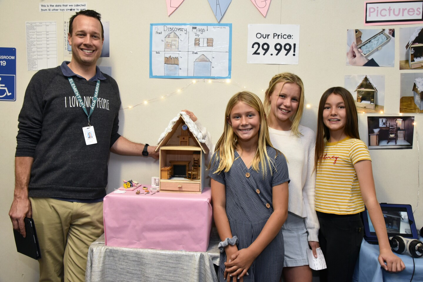 6th Grade teacher John Tiersma and 'Discovery Flags', with student creators Lyla, Ava, and Natalie