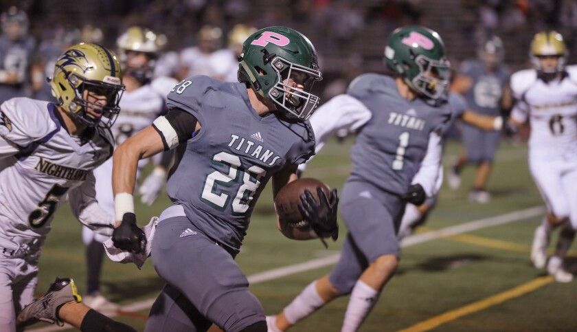 Poway's Josh Butler runs for his second touchdown of the game.