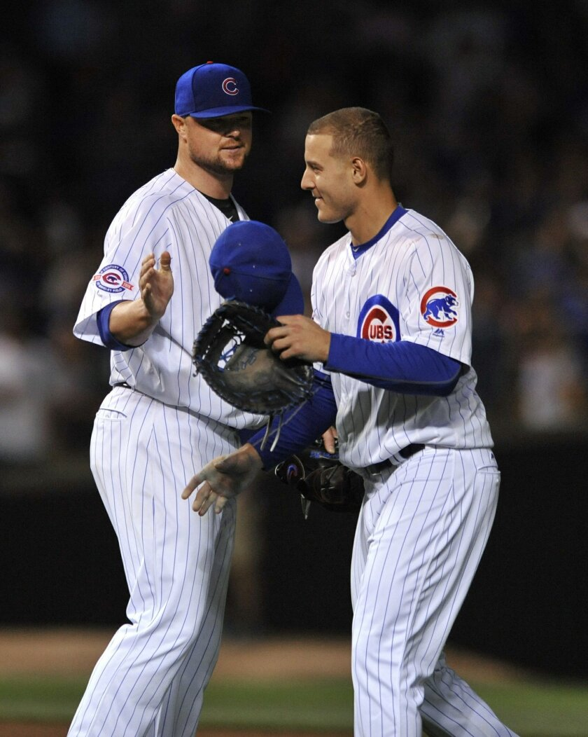 Chicago Cubs' Anthony Rizzo right, celebrates with starting pitcher Jon Lester after the Cubs defeated the Los Angeles Dodgers 2-1 in a baseball game Wednesday, June 1, 2016, in Chicago. (AP Photo/Paul Beaty)