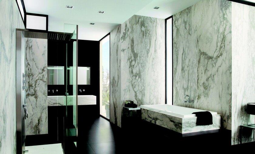 Thin porcelain tile slabs create stylish, low-maintenance shower walls.