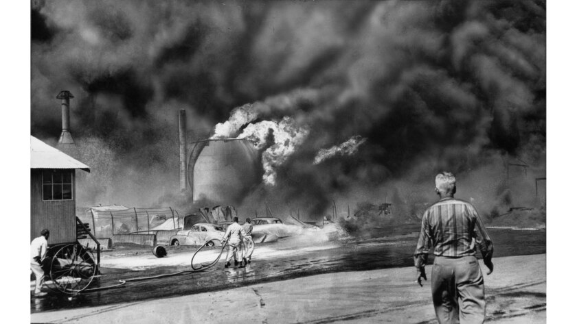 May 22, 1958: Flames and black oily smoke spew out of a storage tank as a series of fatal explosions rock the Hancock Oil Co. in Signal Hill.