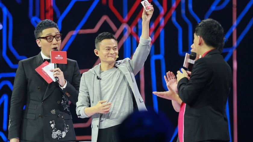 Jack Ma, center, founder of Alibaba Inc., performs a magic trick at the Alibaba 11.11 Global Shopping Festival Countdown Gala in Shenzhen, China, on Nov. 11, 2016.