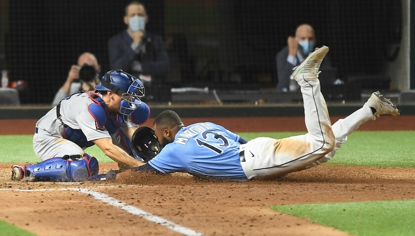 Austin Barnes tags out Manuel Margot at home plate.