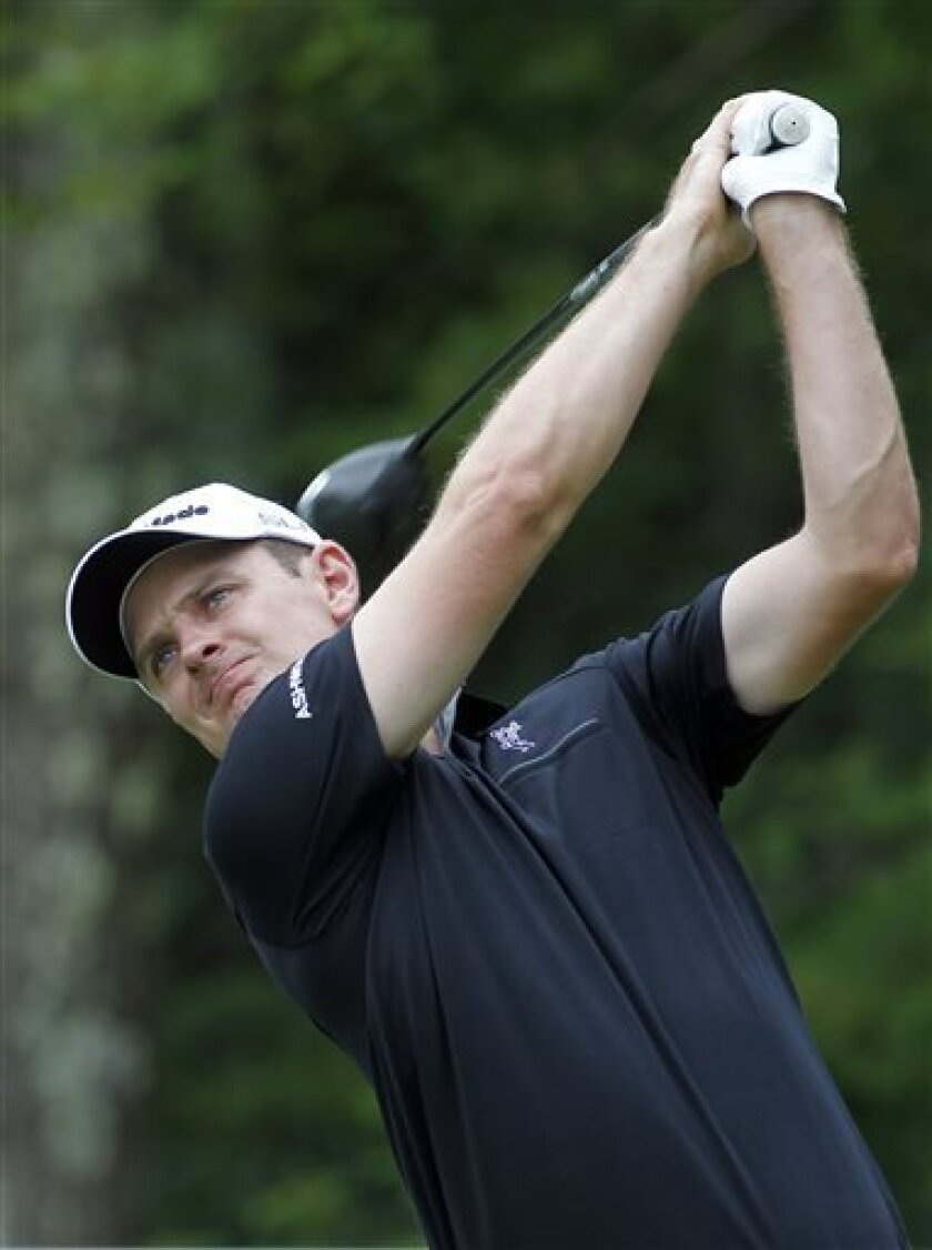 Justin Rose, from England, hits his tee shot on the 18th hole during the second round of the Deutsche Bank Championship golf tournament in Norton, Mass., Saturday, Aug. 31, 2013. (AP Photo/Stew Milne)