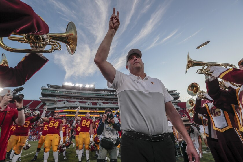 USC coach Clay Helton celebrates after a 52-35 win over UCLA on Nov. 23 at the Coliseum.