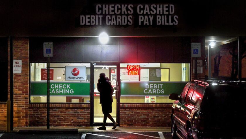 A person leaves a payday loan store in Gaithersburg, Md.