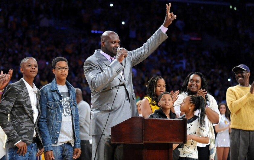 Former Laker Shaquille O'Neal addresses fans during a ceremony to retire his jersey at Staples Center on April 2, 2013.
