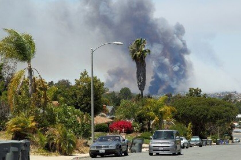 The fire moving through Carlsbad. Photo by Jon Clark