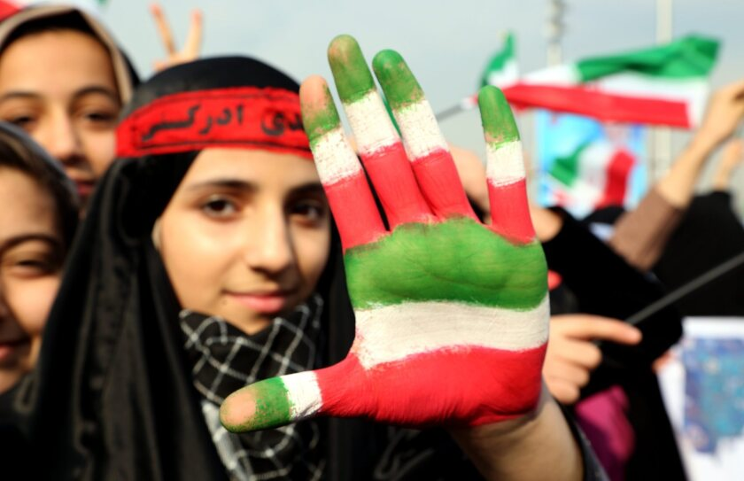 An Iranian girl shows her hand painted with the colors of Iran's flag during a ceremony Tuesday in Tehran's Azadi Square marking the 35th anniversary of the Islamic Revolution.