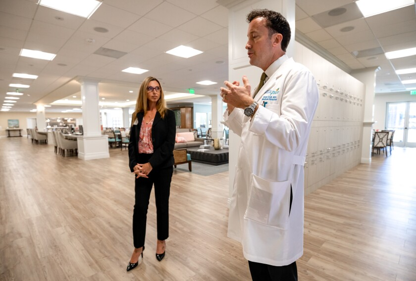 Executive Director Rena Smith and Medical Director Dr. Ross Colt give a tour of the new PACE (Program of All-Inclusive Care for the Elderly) building in San Marcos. Funded by the Gary and Mary West Foundation, this facility will serve as a social and services destination for the region's lower-income seniors who qualify for both Medicare and Medicaid.