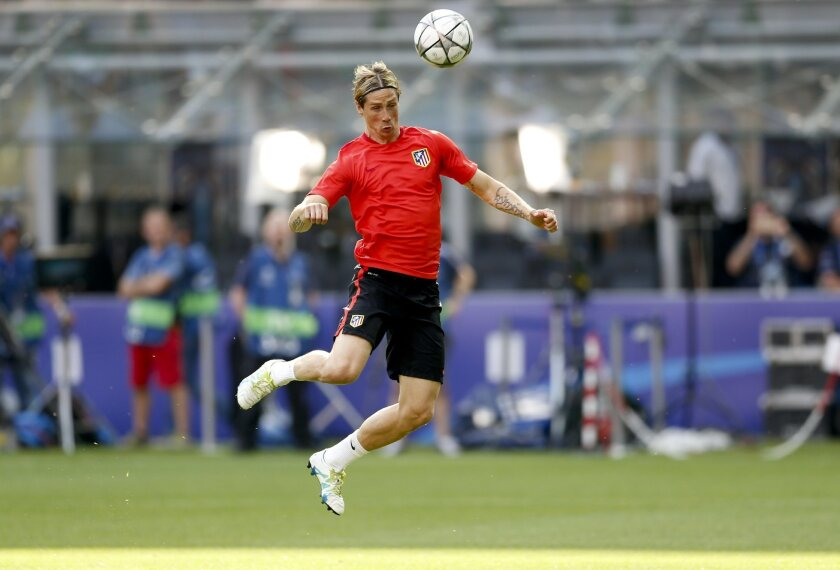 Atletico's Fernando Torres heads the ball during a training session at the San Siro stadium in Milan, Italy, Friday, May 27, 2016. The Champions League final soccer match between Real Madrid and Atletico Madrid will be held at the San Siro stadium on Saturday, May 28. (AP Photo/Manu Fernandez)