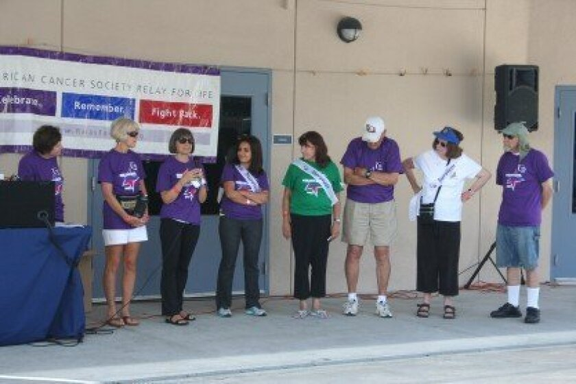 Cancer survivors sharing their stories at the start of the inaugural Relay For Life of Del Mar. Photo/Kristina Houck