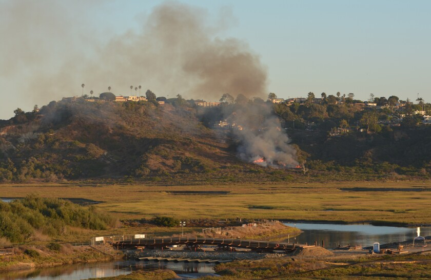 A small brush fire burned near the San Elijo Lagoon in Solana Beach Thursday, Oct. 3, 2019.