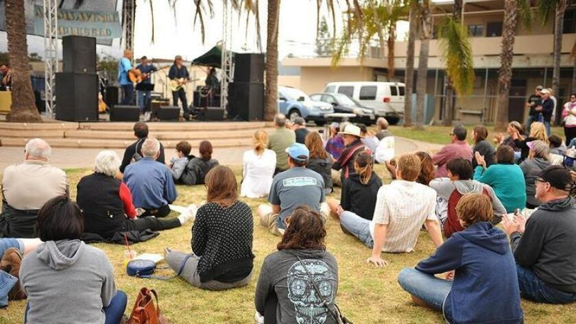At last year's Adams Avenue Unplugged, Tim Flannery and the Lunatic Fringe performed at a park in Normal Heights. (Jared Gase)