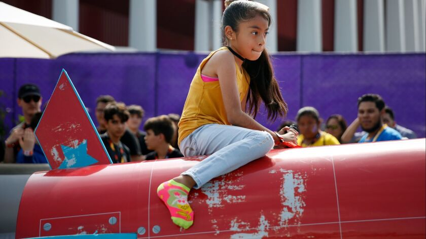 LOS ANGELES, CA-JUNE 15, 2019: Hayllee Galaviz, 9, rides a rocket during a summer block party for Fo