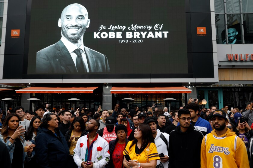 Fans gather near a memorial for Kobe Bryant on Jan. 29, 2020, at Staples Center in Los Angeles.