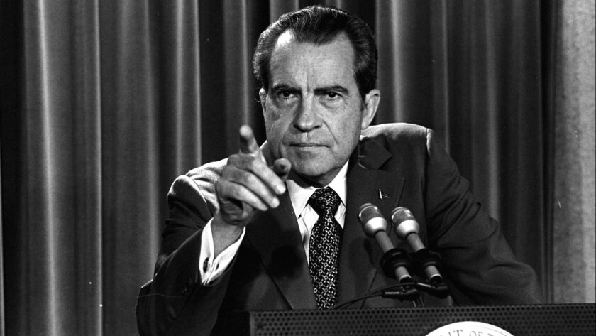 FILE - In this March 15, 1973 file photo, President Nixon tells a White House news conference that h
