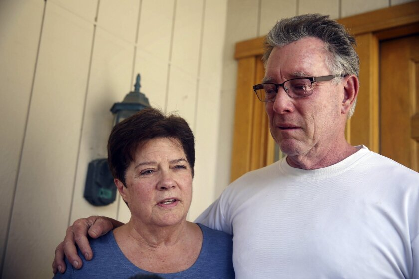 Liz Sullivan, and Jim Steinle, parents of shooting victim Kathryn Steinle, talk to reporters outside their home in Pleasanton, Calif.
