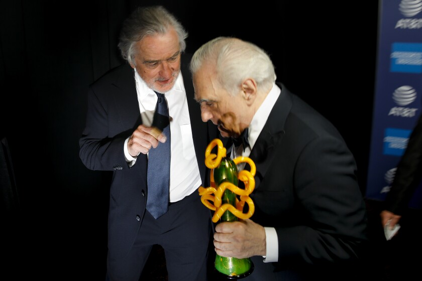 """Robert De Niro, left, and director Martin Scorsese, backstage after De Niro presented him with the """"Sonny Bono Visionary Award,"""" for his film """"The Irishman,"""" at the 2020 Palm Springs International Film Festival Film Awards Gala"""