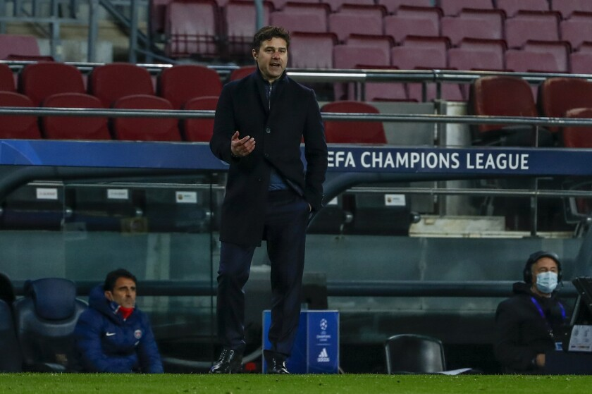 PSG's head coach Mauricio Pochettino gestures during the Champions League round of 16, first leg soccer match between FC Barcelona and Paris Saint-Germain at the Camp Nou stadium in Barcelona, Spain, Tuesday, Feb. 16, 2021. (AP Photo/Joan Monfort)