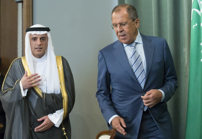 Russian Foreign Minister Sergei Lavrov, right, and Saudi counterpart Adel Jubeir arrive at a news conference after their meeting in Moscow on Aug. 11, 2015.