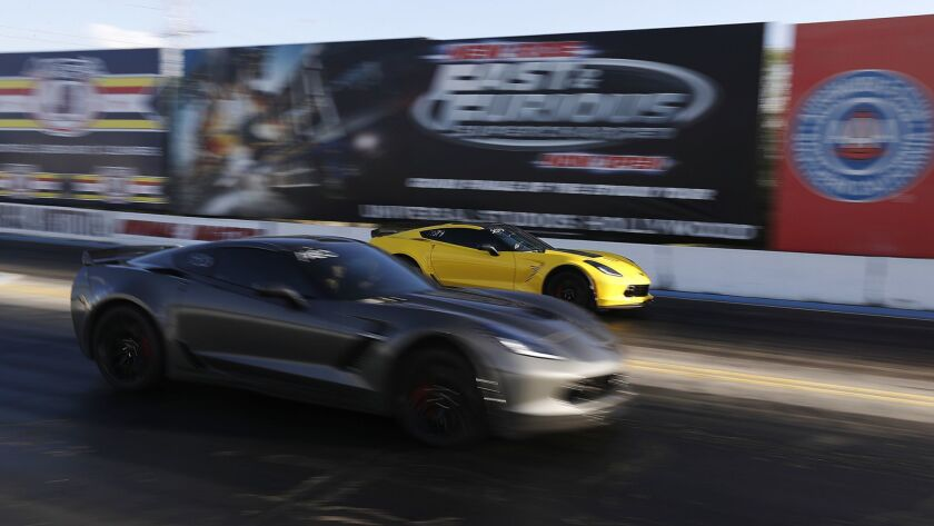 IRWINDALE, CALIF. - APR. 19, 2018. A pair of late model Corvettes drag race at the Irwindale Speed