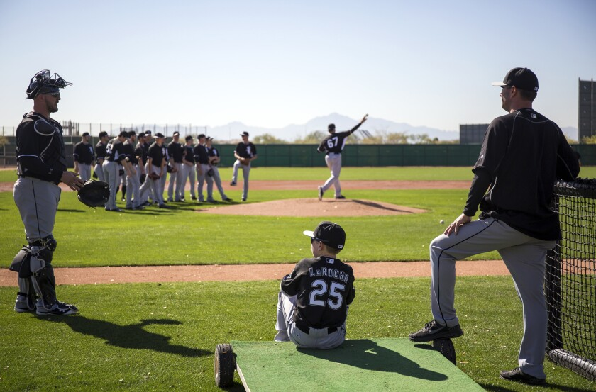 Drake LaRoche, 14, watches the White Sox practice last month.