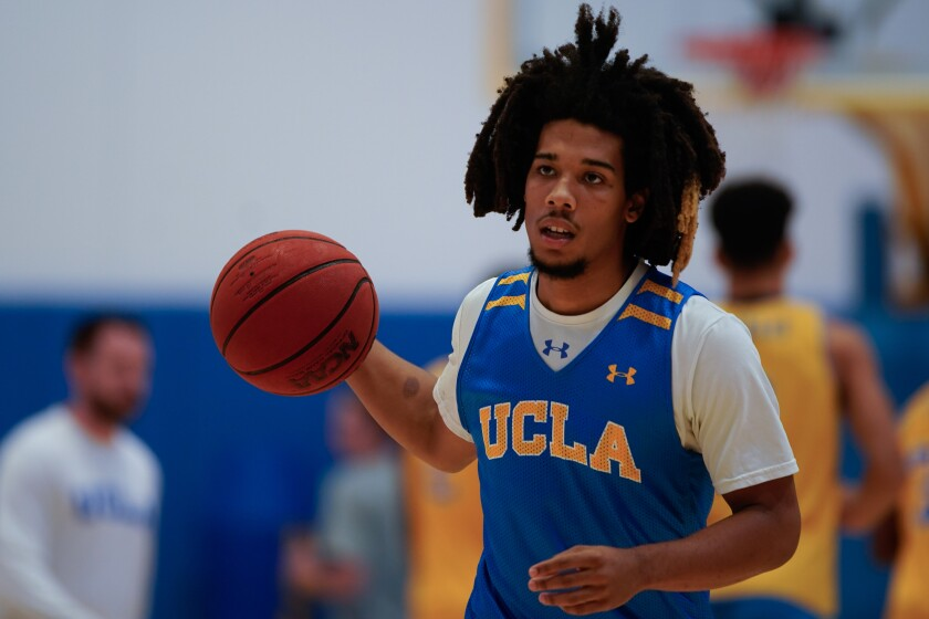 UCLA's Tyger Campbell dribbles during practice at the Mo Ostin Basketball Center on Thursday in Westwood.